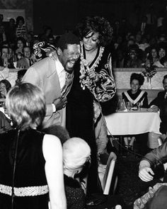 Diana Ross with Boston Celtics' Bill Russell at The Supremes' farewell performance at the Frontier Hotel in Las Vegas January 14 Gary Cooper, Barbara Stanwyck, Yo Claudio, Bill Bruford, Chris Squire, Wilson Sisters, Beatles One, Bill Russell, Nancy Wilson