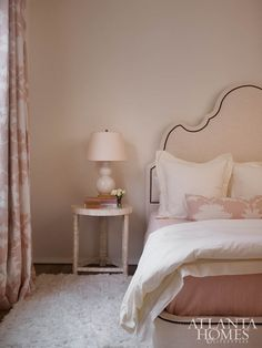 The all-pink bedroom was inspired by a floral Schumacher fabric.