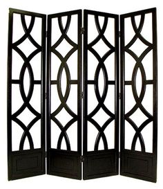 define space in the den or library with this lovely divider featuring abstract upholstery