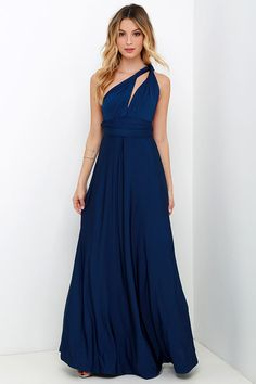 """Any which way you wrap it, the Always Stunning Convertible Navy Blue Maxi Dress is one amazing dress! Two, 82"""" long lengths of fabric sprout from an elastic waistband and wrap into dozens of possible bodice styles including halter, one-shoulder, cross-front, strapless, and more. Stretchy navy fabric has a satiny sheen, and a full length maxi skirt pairs perfectly with any choice you make up top. Want Styling Tips? <a href='http://bit.ly/HowToWearIt' target='_blank'>See How To Wear It!</a>"""