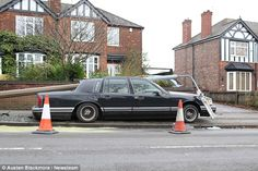 The lovingly-restored American Lincoln Towncar was crushed by a falling lamppost