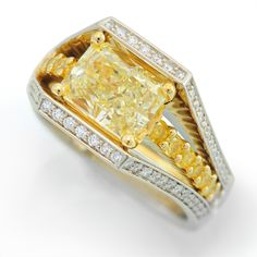 Interlude Collection - 2.69ct Fancy Yellow Radiant Cut Diamond set in 18k Yellow and White Gold accented with White and Fancy Yellow Diamonds.