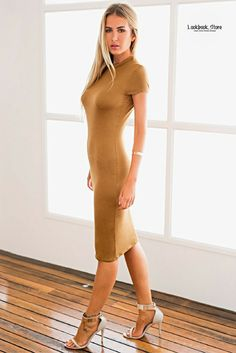 Dress // Show off your perfect curves in this figure-hugging brown midi sheath dress.