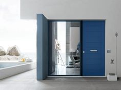 Blue Evolution 3TT door by Oikos Venezia. The first modern safety door with heat barrier frame.
