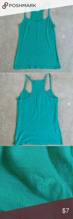 🆕American Eagle Racerback Tank🆕 This racerback tank from American Eagle is a fun and bright green color. It is made from 100% cotton and features bright green stitching. American Eagle Outfitters Tops Tank Tops