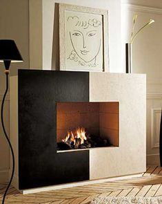 black and white fireplace mantel design, nice modern look, could I make this style facade for my fireplace? Maybe in beach colors &/or textures? Sand or shells on one side & waterlike glass tiles or metal on other
