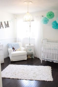 White nursery with splashes of color. (gender neutral!) change the color of the accents when you find out gender.