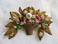 Vintage Miriam Haskell brooch floral basket with seed pearl flowers, colored bead accents and center baroque pearl. Multilayer details with