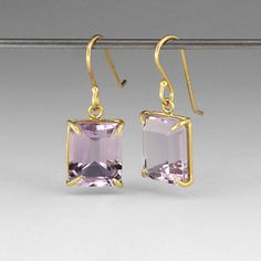 "18k yellow gold, small emerald cut lavender amethyst. These earrings are 7/8"" long and 3/8"" wide."