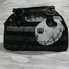 Purse Black Nightmare before Christmas purse...bought it when the movie came out at hot topic never used it it sat in my closet..tag says DISNEY....SPENT $80 couldn't say no to my daughter....Clean in and out....Don't know if is authentic...The tag does not say it is... DISNEY Bags Mini Bags