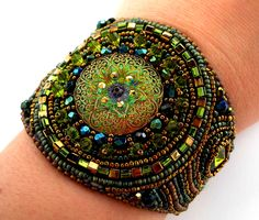 Green Bead Embroidery Bracelet Cuff  Olive Bead Embroidered Secret Garden. $125.00, via Etsy.
