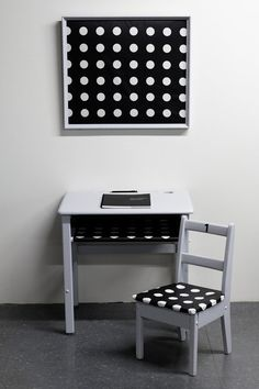 Set of retro kids desk and the school chair with big white dots in black laminated cotton
