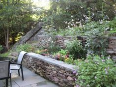 """idea for steep back yard... """"A steep hill was terraced into a gorgeous triple-decker garden complete with waterfall."""""""