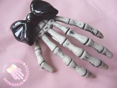 Black skeleton hand hair clip with bow by SugarCoatedSprinkles,