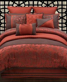 My new comforter set! This screams my name . .  . the colors are much deeper and richer than seen in the photograph. The chocolate brown is almost black and the red is more red than orange. Still has the slight Asian twist with the modern cherry blossom design.