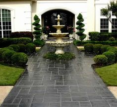 house exterior design stamped concrete hedge plants fountain