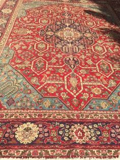 Unusual Iranian hand knotted Carpet100% wool on Cotton BackingExhuberating Reds, with a dash of Duck Egg/ turquoise Blue Accents and creams....127190690