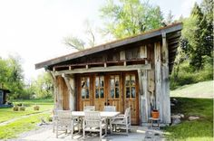 Reclaimed wood cottage with outdoor patio furniture.