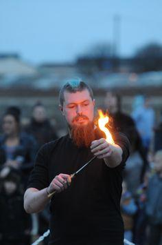 Fire juggler at Littlehaven Promenade opening entertaining crowds.