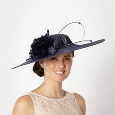 This navy fascinator from Debut is styled with an oversized saucer and a  headband. It has a lovely flower detail with quill trims. 1b03c5d136b4