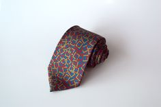 MINGLING SQUARES - Featuring the complimentary colours of maroon and brown squares set on a green background; this tie will go with just about any suit. It encapsulates the start of all business – mingling
