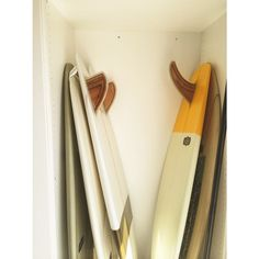 Plywood fins, hand-crafted by Gully, on a few Almond boards.