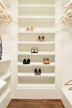 Shoe shelves in closet.