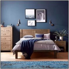 The Corniche bedroom range is crafted from dark American oak. Contrast with dark blue walls for a bold and beautiful look. The Corniche bedroom range is crafted from dark American oak. Contrast with dark blue walls for a bold and beautiful look. Dark Blue Bedrooms, Blue Master Bedroom, Blue Bedroom Decor, Master Bedroom Design, Dark Bedroom Walls, Bedroom Designs, Rustic Bedroom Blue, Bedroom Bed, Dark Blue Walls