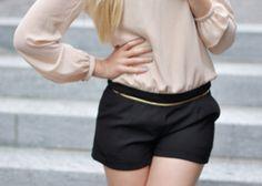 Black shorts, mint nails.