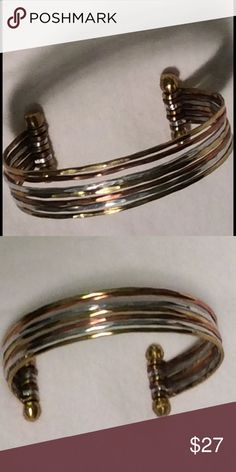 Triple metal cuff bracelet Triple metal cuff bracelet: Copper. Silver. Gold. One size.  Acquired by our stylists and used one time for a photo shoot. Jewelry Bracelets