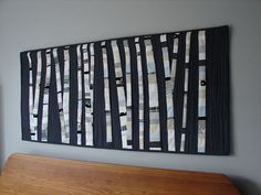Probably could do this with some sort of strip-piecing method.  kind of looks like birch trees...
