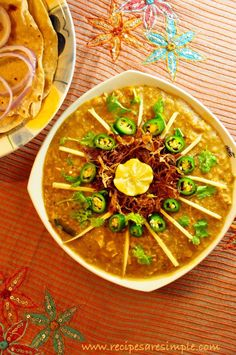 Delicious and Traditional Chicken Haleem. Stewed chicken with wheat and dal - yum served with buttery naan!