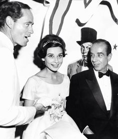 "Audrey Hepburn between Mel Ferrer and Vincente Minnelli at the premiere of ""Gigi"" in 1958."