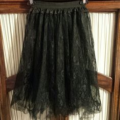 Black lace and tulle skirt This was bought for a costume  It is a one size fits most  It will fit a small to a med in my opinion  Super cute and very shear Very good used condition Skirts