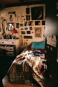 Quirky bedroom with a tumblr feel. Band posters scatter about the walls. Trinkets setting very still on the vintage Dresser. Love it this is my dream bedroom!