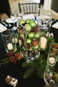 Holiday decorating & ideas - Rustic Christmas centerpiece with pinecones and green glass orbs.