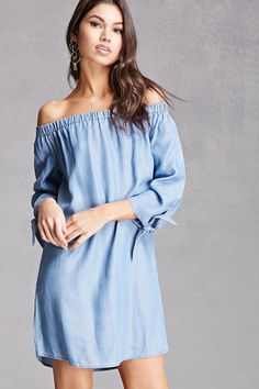 A chambray dress featuring an off-the-shoulder neckline, 3/4 sleeves with self-ties, and a shift silhouette. This is an independent brand and not a Forever 21 branded item.