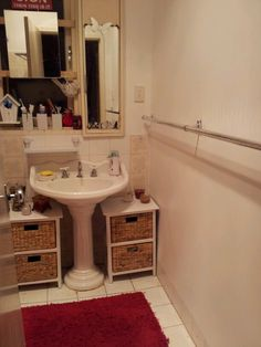small bathroom idea - baskets underneath pedestal sink