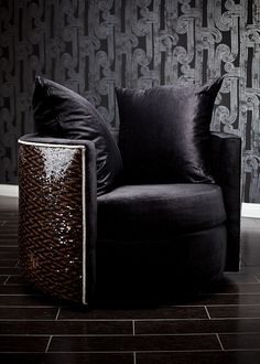 4222 REESE SWIVEL CHAIR WITH SEQUINS This ultra-glam chair is an absolutely incredible addition to your home. Constructed on a solid wood frame base wrapped in cushioning and black velvet, this retro chair sits upon a swivel base. However, the true masterpiece is the back. Upholstered in beautiful sequins and trimmed with shiny rhinestones, it brightens up and adds instant glamor to any room. This chair is undeniable fabulous. It can be customized to make it truly unique and yours alone!