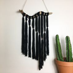 Big Sur Driftwood Knotted Black Yarn Wall Hanging by RadicalSouls on Etsy https://www.etsy.com/listing/476595770/big-sur-driftwood-knotted-black-yarn