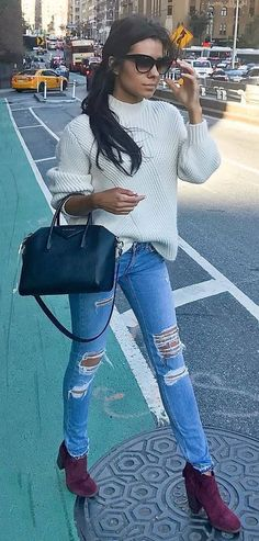 awesome outfit idea / white sweater + bag + stripped jeans + boots