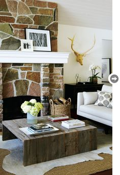 Hide skin over the mat. Nice raw coffee table and muted grey couch