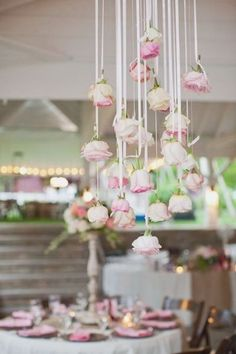 How pretty is this hanging arrangement of pink roses? So simple, yet high impact | www.stylemepretty.com
