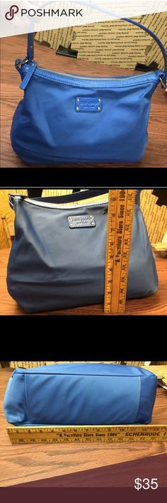 Kate Spade Blue Nylon Hobo Bag Bright Blue Authentic Kate Spade Nylon Hobo style purse. Measures 9 inches high x 13 inches wide with about an 8 inch strap drop. Minor scuffs and normal wear and tear. Looks great and has a lot of life left! Kate Spade Bags Hobos