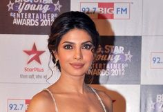 Indian Bollywood actress Priyanka Chopra poses on the red carpet as she attends the Big Star Young Entertainer Awards ceremony in Mumbai on March 25, 2012.