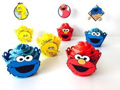 Sesame street theme Cupcake toppers and wrappers. Bring Elmo, Cookie Monster, Big Bird to your party!