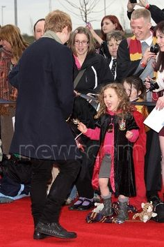 Oh my gosh...little girl meeting Rupert Grint. This would be my exact reaction!