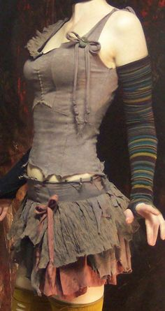 gray/brown tattered circus tank top & skirt with striped gloves. want!
