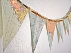 Map your love of adventure! Super easy to make.cut a map into triangles (or any shape you choose), punch a hole in two of the corners and string ribbon or rope through. Great way to display maps from your off-campus studies! Map Globe, Old Maps, Antique Maps, Deco Table, Crafty Craft, Classroom Decor, Science Classroom, Boy Room, Just In Case