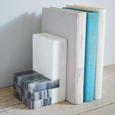 Modern marble. In black and white, these hefty bookends keep your bookshelves in geometric order.